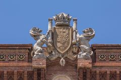 Sculpture and crest atop the Arc de Triomf in Barcelona, Spain.  Royalty Free Stock Photos