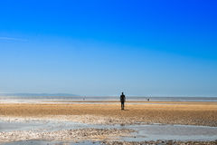 Sculpture on Crosby Beach, the Another Place by Anthony Gormley Royalty Free Stock Photography