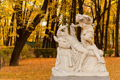 Sculpture of Cupid and Psyche. Marble sculpture of Cupid and Psyche (by Giulio Kartar probably, XVII century) in old park Summer garden in St.Petersburg, Russia Royalty Free Stock Images