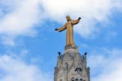 Sculpture de Jesus Christ parmi des nuages à Barcelone, Espagne Photographie stock