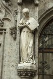 Sculpture of the woman as decoration at the Gothic style building Stock Images