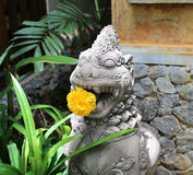 Sculpture of the deity with a flower Royalty Free Stock Photo