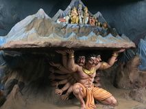 A sculpture depicting demon King Ravana lifting Mountain Kailash. A mythological sculpture depicting demon King Ravana lifting Mountain Kailash Royalty Free Stock Images