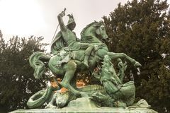 Sanit George kills dragon. Sculpture depicting the saint as a horseman killing the dragon. The legend of Saint George and the Dragon describes the saint taming Stock Photography
