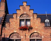Sculpture detail on building, Bruges. Stock Image
