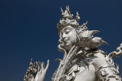 Sculpture detail with white Buddha in all-white buddhist temple Stock Image