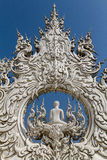 Sculpture detail with white Buddha in all-white buddhist temple Stock Photography
