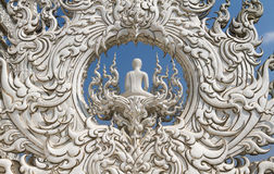 Sculpture detail with white Buddha in all-white buddhist temple Stock Images