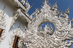 Sculpture detail with white Buddha in all-white buddhist temple Royalty Free Stock Images