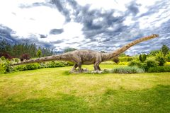 Big Dinosaur in Nature. Sculpture of dinosaur Sauropoda , Diplodocus in live size royalty free stock photo