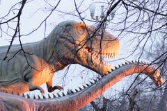 Sculpture of Dinosaurs in winter park in Kiev Ukraine 2018. Sculpture close-up royalty free stock photography