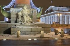 Sculpture of the Dnieper River. Vasilyevsky Island.  Exchange building. Rostral columns. New Year`s St. Petersburg.