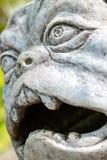 Sculpture dog monster in Park of Branicki Palace. Stone sculpture of figure of dog-monster in Park of Branicki Palace and Medical University of Bialystok in Stock Photo