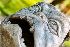 Sculpture dog monster in Park of Branicki Palace. Stone sculpture of figure of dog-monster in Park of Branicki Palace and Medical University of Bialystok in Royalty Free Stock Photo