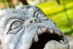Sculpture dog monster in Park of Branicki Palace. Stone sculpture of figure of dog-monster in Park of Branicki Palace and Medical University of Bialystok in Stock Photos