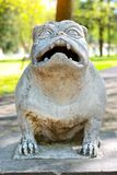 Sculpture dog monster in Park of Branicki Palace. Stone sculpture of figure of dog-monster in Park of Branicki Palace and Medical University of Bialystok in Royalty Free Stock Photos