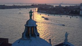 The sculpture on the dome of the Cathedral of San Giorgio Maggiore on the background of evening twilight. Venice, Italy. The sculpture on the dome of the stock video