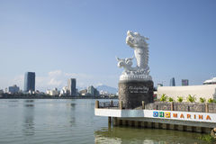 The sculpture of the dragon on the background of the Han river on a sunny day. Da Nang, Vietnam Royalty Free Stock Photo