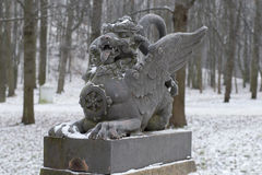 The sculpture of the dragon on the bridge closeup gloomy winter day. Tsarskoye Selo Royalty Free Stock Photo