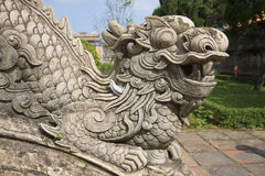 The sculpture of the dragon close up. A fragment of the porch of the Emperor's study in the forbidden city. Hue Royalty Free Stock Image