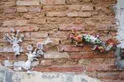 Sculpture dragon and flower from cement on Brick wall Background Stock Images