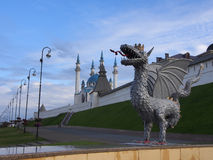 Sculpture dragon Zilant at the entrance to the subway on the background of the Kazan Kremlin royalty free stock image