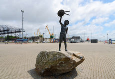 Sculpture Dreams of childhood (Boy with dog) in Klaipeda Stock Images