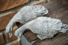 Sculpture. Duck sculpture on wooden floors and old brick walls Royalty Free Stock Photo