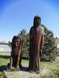 Sculpture of an elderly man and a lion stock photos