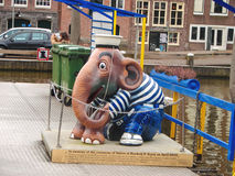 Sculpture elephant sailor on the docks of pleasure boats  in Ams Stock Photo