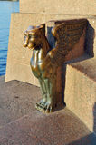 Sculpture on the embankment of the Neva river. Four of Griffin located on the sides of the granite pier Universitetskaya embankment (Saint-Petersburg) on the royalty free stock photo