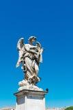 Sculpture en ange de pont de St Angelo à Rome Photographie stock libre de droits