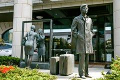 Sculpture en bronze en homme et en femme sur la rue de Jeju, Corée du Sud Photographie stock libre de droits
