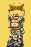 Sculpture en céramique frappée vers le haut de Bouddha de sourire Photo libre de droits