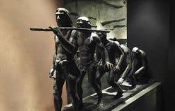 Sculpture en en cuivre d'évolution humaine photographie stock