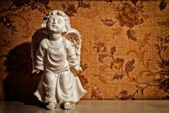 Sculpture en cupidon de cru Images stock