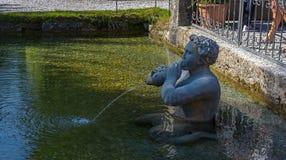 Sculpture en pierre dans le jardin du palais de Hellbrunn à Salzbourg, Autriche image libre de droits