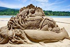 Sculpture en sable du monde de fond de la mer Photographie stock