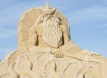 Sculpture en sable du poseidon grec d'un dieu Photos stock