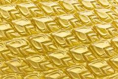 Sculpture en texture des échelles d'or de dragon Photographie stock libre de droits