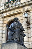 The sculpture at the entrance to the concert hall of the Czech Philharmonic in the Rudolfinum in Prague. Royalty Free Stock Image