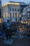 Sculpture in the evening in Netherlands Utrecht a very beautiful dutch city. A lot of people are walking next to waterfront in the city during evening when Royalty Free Stock Photo
