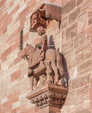 Sculpture on the facade of the Basel Minster. The Basel Minster (German: Basler Munster) is one of the main landmarks and tourist attractions of the Swiss city Stock Images