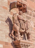 Sculpture on the facade of the Basel Minster. The Basel Minster (German: Basler Munster) is one of the main landmarks and tourist attractions of the Swiss city Royalty Free Stock Images