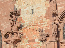 Sculpture on the facade of the Basel Minster. The Basel Minster (German: Basler Munster) is one of the main landmarks and tourist attractions of the Swiss city Stock Photography