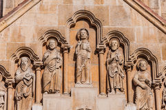 Sculpture on the facade of the Church of Jak in the City Park of Budapest. Sculpture on the facade of the Church of Jak is a functioning Catholic chapel in the Stock Photo