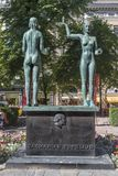 Sculpture Fact and Fable in Esplanade Park. Helsinki. HELSINKI, FINLAND - JULY 16, 2016: Sculpture Fact and Fable in Esplanade Park is cast in bronze and its stock image