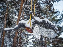 Sculpture of a fairy on a swing covered with snow, Novosibirsk, Russia royalty free stock images