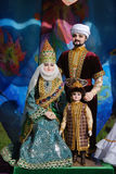 A sculpture of a family in traditional costumes Royalty Free Stock Images
