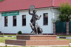 Sculpture of a farmer with coin, Lepel, Belarus Stock Photography